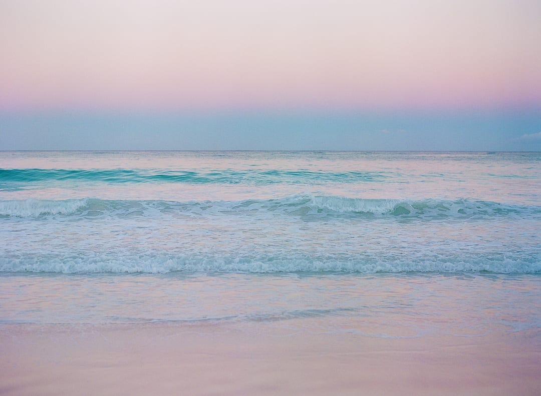 sunrise Bahamas beach pink blue