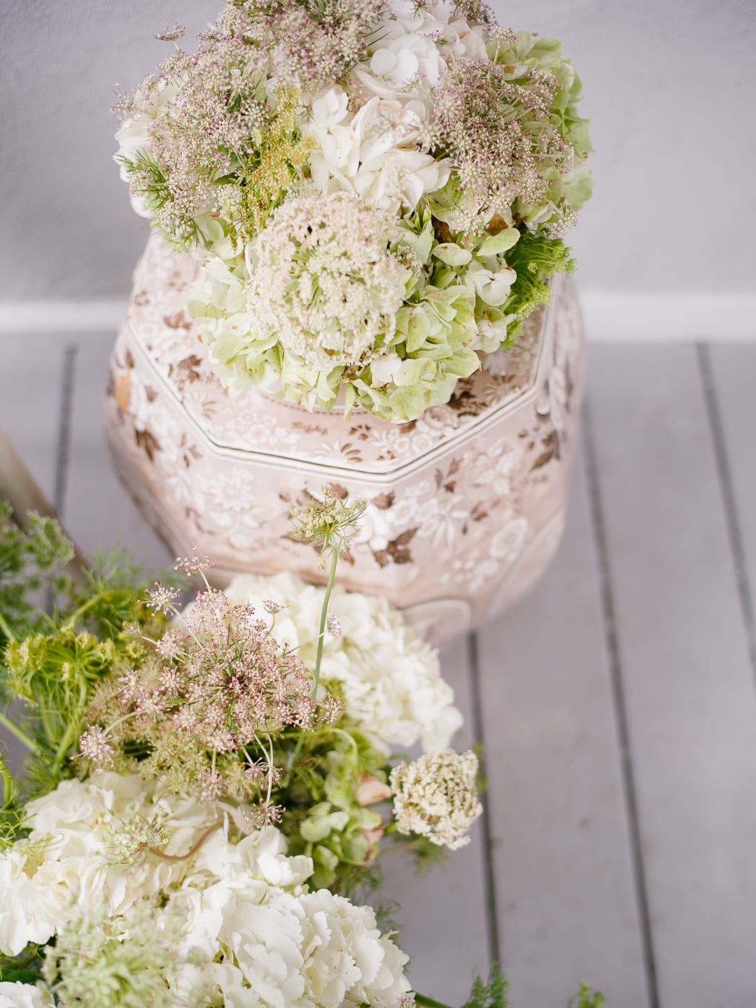 Tight shot of a floral arrangement including and Queen Anne's Lace