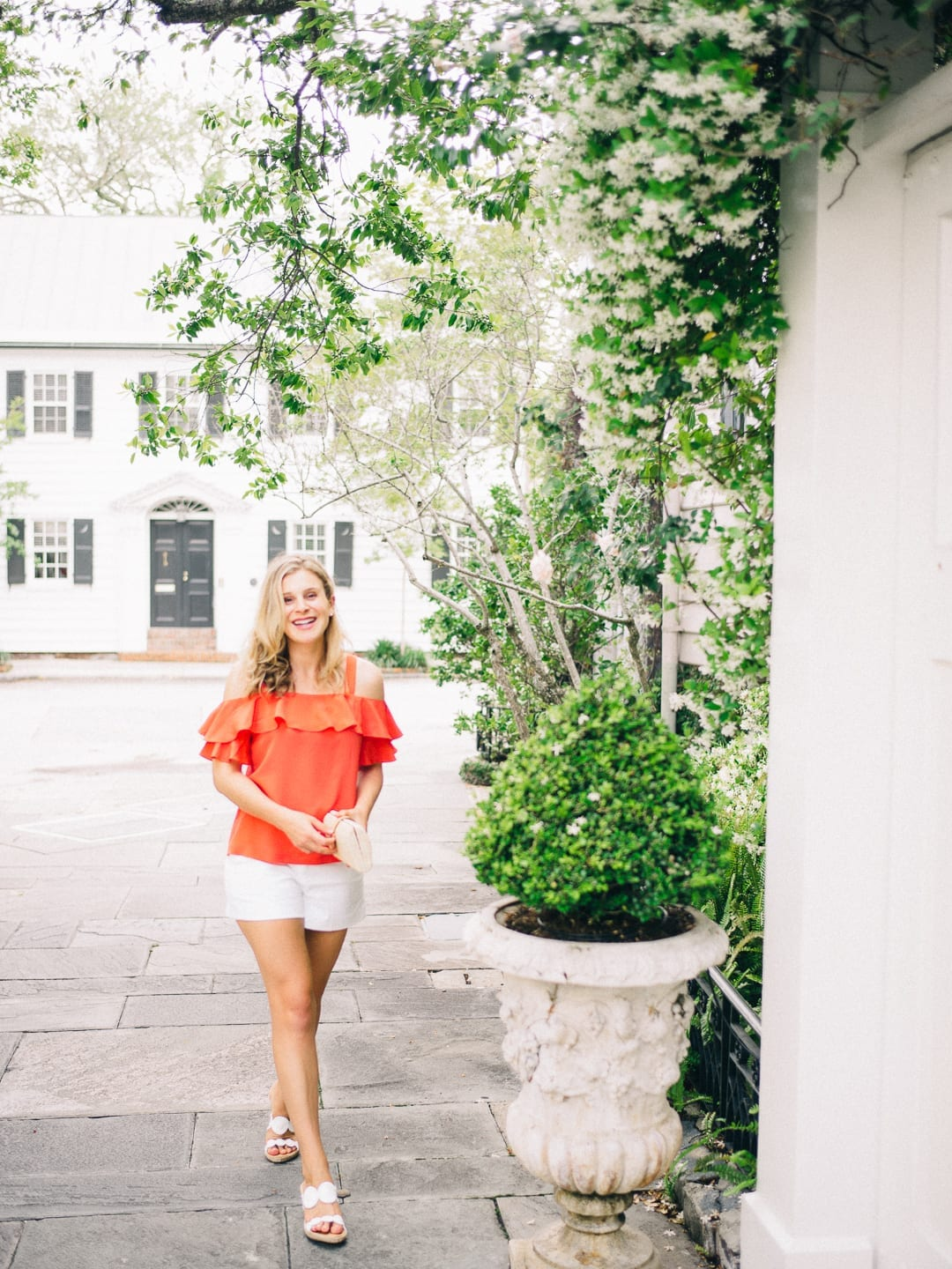 girl in red top downtown charleston