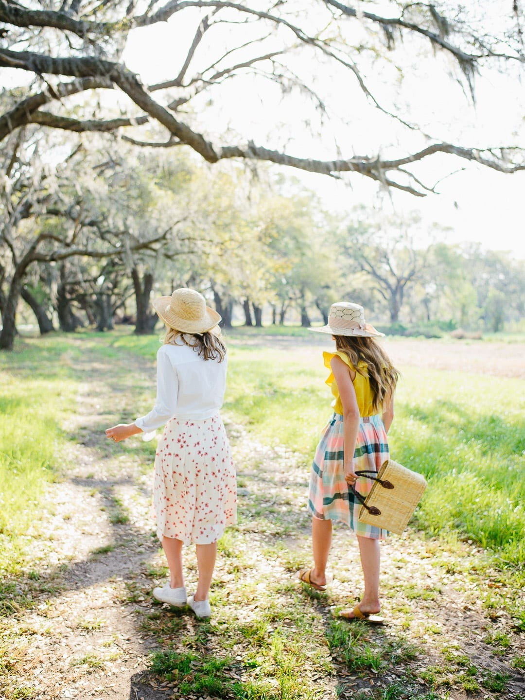 girls walking live oaks